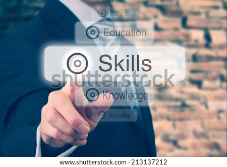 Businessman pressing a Skills concept button. Instagram Styling Applied. - stock photo