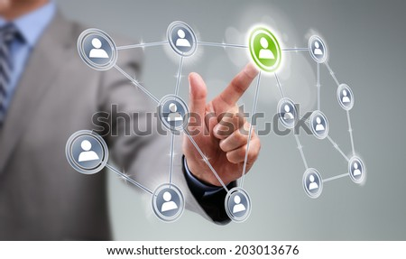 Businessman pressing add friend icon on visual touch screen concept for social media, network, community and  internet marketing
