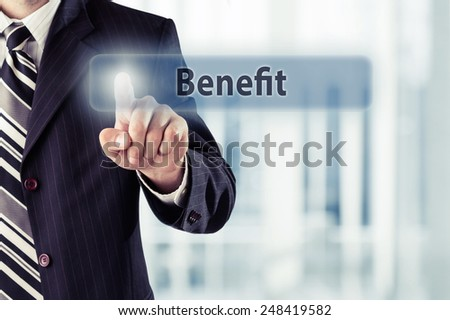 Businessman pressing Benefit button at his office. Toned photo. - stock photo