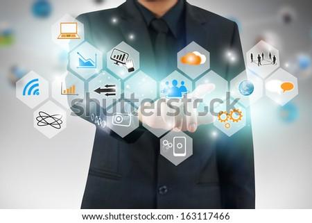 Businessman pressing business diagram  - stock photo