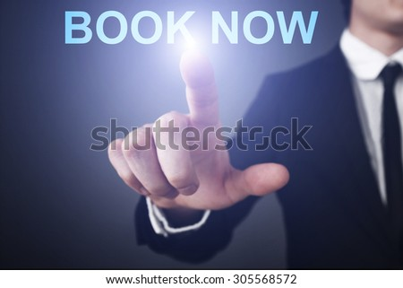 """Businessman pressing button on touch screen interface and select """"Book now"""". Business concept. Internet concept. - stock photo"""