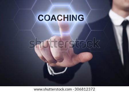 """Businessman pressing button on touch screen interface and select """"Coaching"""". Business concept. Internet concept. - stock photo"""