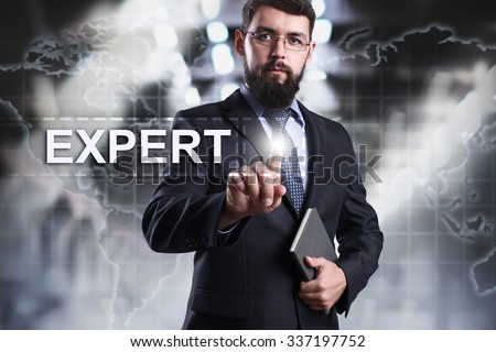 Businessman pressing button on touch screen interface and select Expert. Business concept. Internet concept. - stock photo