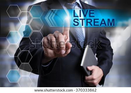 "Businessman pressing button on touch screen interface and select ""Live stream"". Business concept. Internet concept. - stock photo"