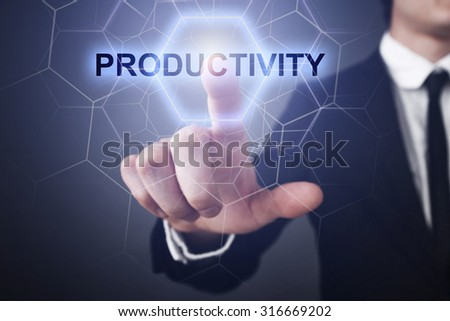 "Businessman pressing button on touch screen interface and select ""productivity"".  - stock photo"