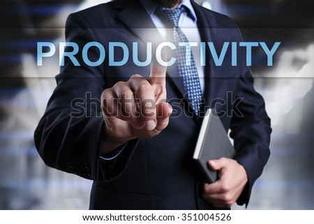 Businessman pressing button on touch screen interface and select productivity.  - stock photo
