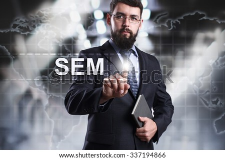 Businessman pressing button on touch screen interface and select SEM. Business, internet, technology concept. - stock photo