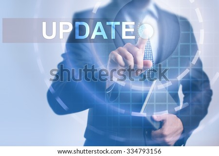 Businessman pressing button on touch screen interface and select Update. Business, internet, technology concept. - stock photo