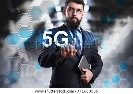 """Businessman pressing button on touch screen interface and selecting """"5G"""". Business, internet and tehcnology concept. - stock photo"""