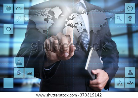 businessman pressing button on virtual screen. business concept. global business. world map.