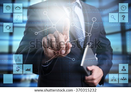 businessman pressing button on virtual screen. communication. network. social network. business concept. - stock photo