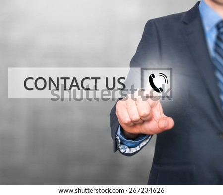 Businessman pressing button on virtual screens. Isolated on grey. Business, technology and internet concept - Stock Image - stock photo