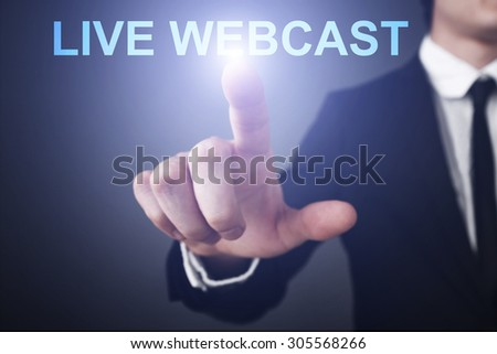 "Businessman pressing button on virtual touch screen  and select ""live webcast"". Business concept. Internet concept. - stock photo"