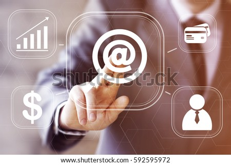 Businessman pressing button search magnifier mail network. Concept virtual loupe email icon.