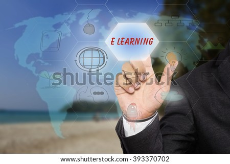 Businessman pressing button touch screen interface and select E LEARNING, E Learning concept.