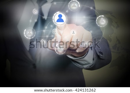 businessman pressing button with contact on virtual screens -business, technology, internet and social networking concept - stock photo