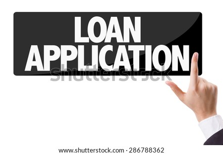Businessman pressing button with the text: Loan Application - stock photo