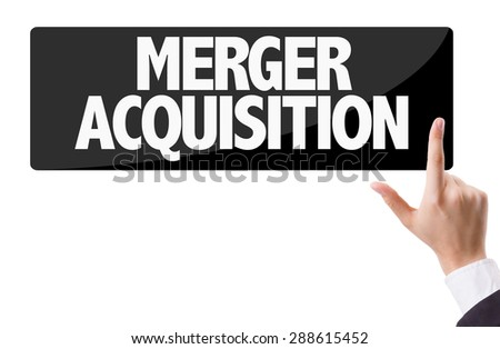 Businessman pressing button with the text: Merger Acquisition - stock photo