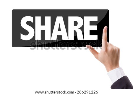 Businessman pressing button with the text: Share - stock photo