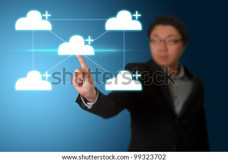 Businessman pressing cloud computing buttons on a touch screen - stock photo