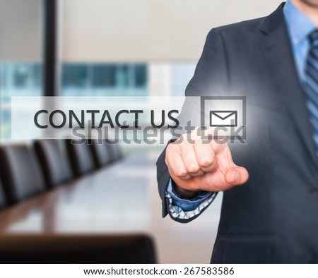 Businessman pressing Contact Us button on virtual screens. Mail Icon Isolated on office. Business, technology and internet concept - Stock Image - stock photo