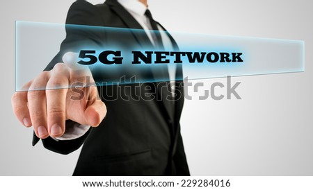 Businessman Pressing 5g network Text on Transparent Glass. - stock photo