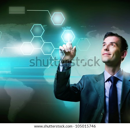 Businessman pressing high tech buttons on a virtual touchscreen interface - stock photo
