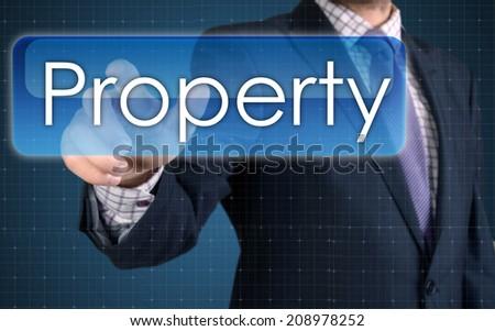Businessman pressing high tech type of modern Property button  - stock photo