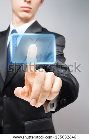 Businessman pressing high-tech virtual button with space for your text or icon.