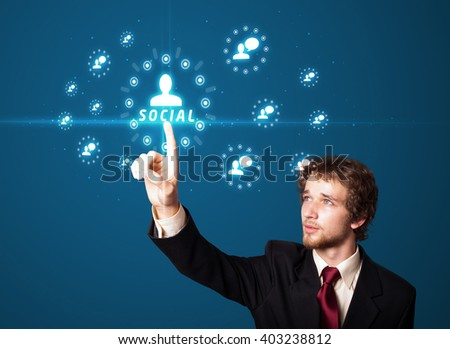 Businessman pressing modern social buttons on a virtual background