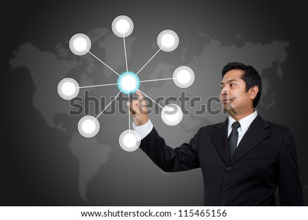 Businessman pressing modern social network on a virtual background