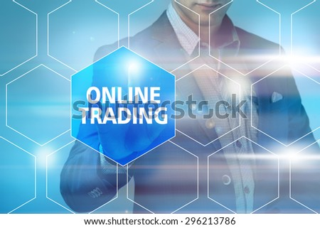 Businessman pressing online trading button on virtual screens. Business, technology, internet and networking concept. - stock photo