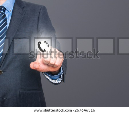 Businessman pressing phone button, visual screen. Communication concept. Isolated on grey. Stock Image - stock photo