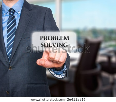 Businessman pressing Problem Solving  button on visual screen. Isolated on office background. Stock Photo - stock photo