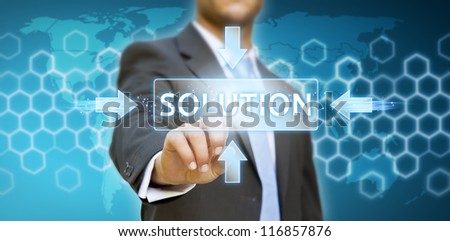 Businessman pressing solution button - stock photo