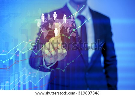 businessman pressing support button on virtual screen - stock photo