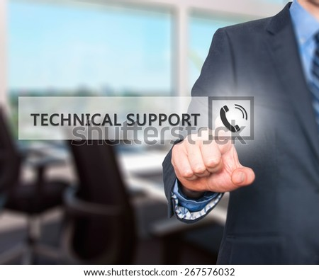 Businessman pressing technical support button on virtual screens. Phone Icon. Isolated on office. Business, technology, internet and networking concept -  Stock Image - stock photo