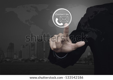 Businessman Pressing Telephone And Mail Icon Button Over World Map And City Tower Contact Us