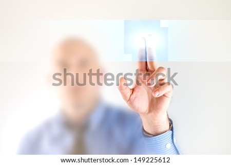 Businessman pressing touch screen button of modern interface