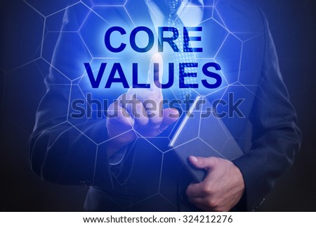 "Businessman pressing touch screen interface and select ""Core values""."