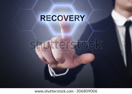 "Businessman pressing touch screen interface and select icon ""recovery"". Business concept. Internet concept. - stock photo"