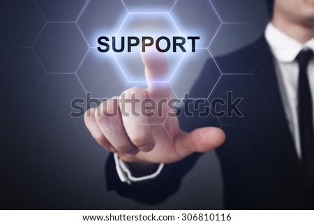 """Businessman pressing touch screen interface and select icon """"support"""". Business concept. Internet concept. - stock photo"""