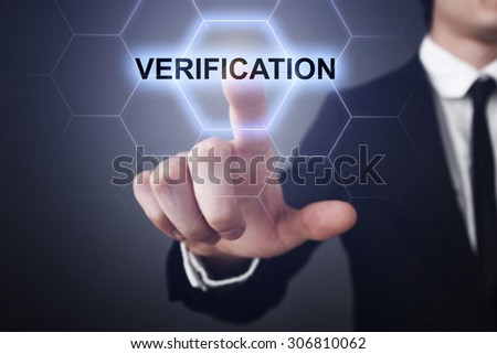 "Businessman pressing touch screen interface and select icon ""verification"". Business concept. Internet concept. - stock photo"