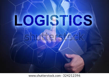 "Businessman pressing touch screen interface and select ""Logistics""."