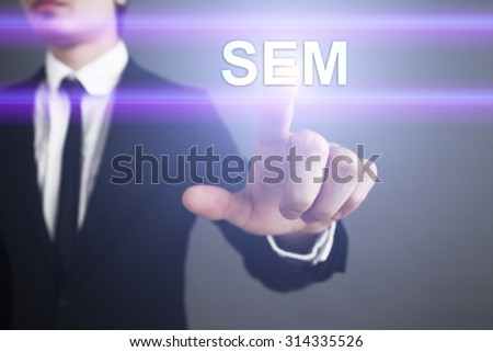 """Businessman pressing touch screen interface and select """"SEM"""". Business concept. Internet concept. - stock photo"""