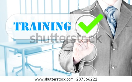Businessman pressing touch screen interface training checkbox - stock photo