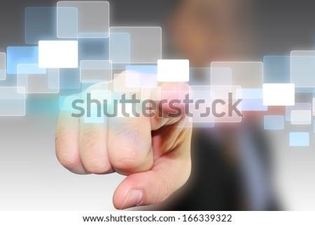 Businessman pressing touchscreen  - stock photo