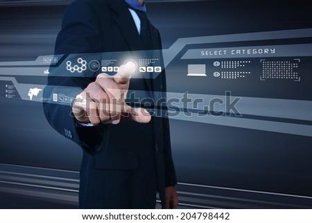 Businessman pressing virtual buttons - stock photo