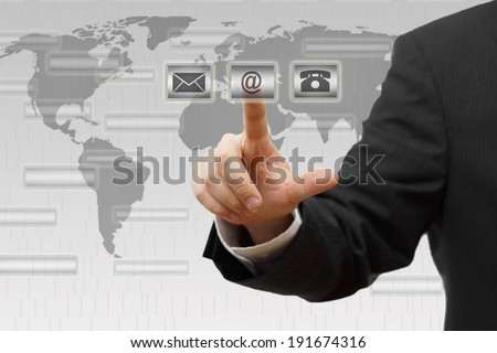 Businessman pressing virtual ( mail,phone,email ) buttons. Contact us concept - stock photo