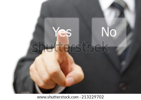 businessman pressing yes virtual button - stock photo